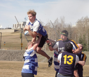 A rugby player skies for the ball during Saturday's tournament. Kurtis Gosney/Sun Star
