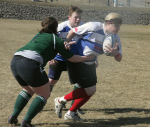 A member of the Fairbanks Ravens fights her way through the defense during the rugby tournament. Kurtis Gosney/Sun Star