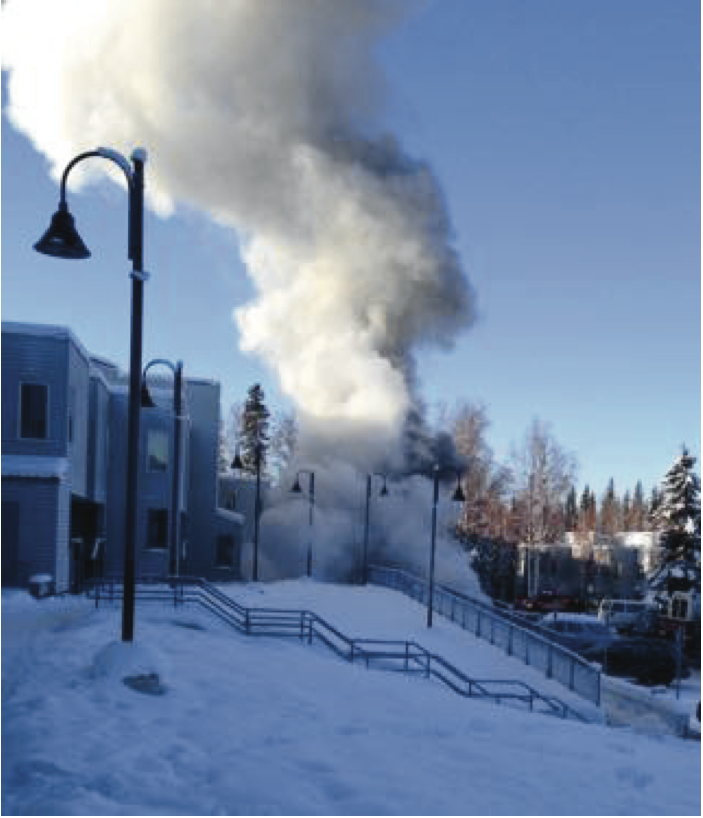 Smoke from Monday's car fire. - Cordero Reid / UAF Student