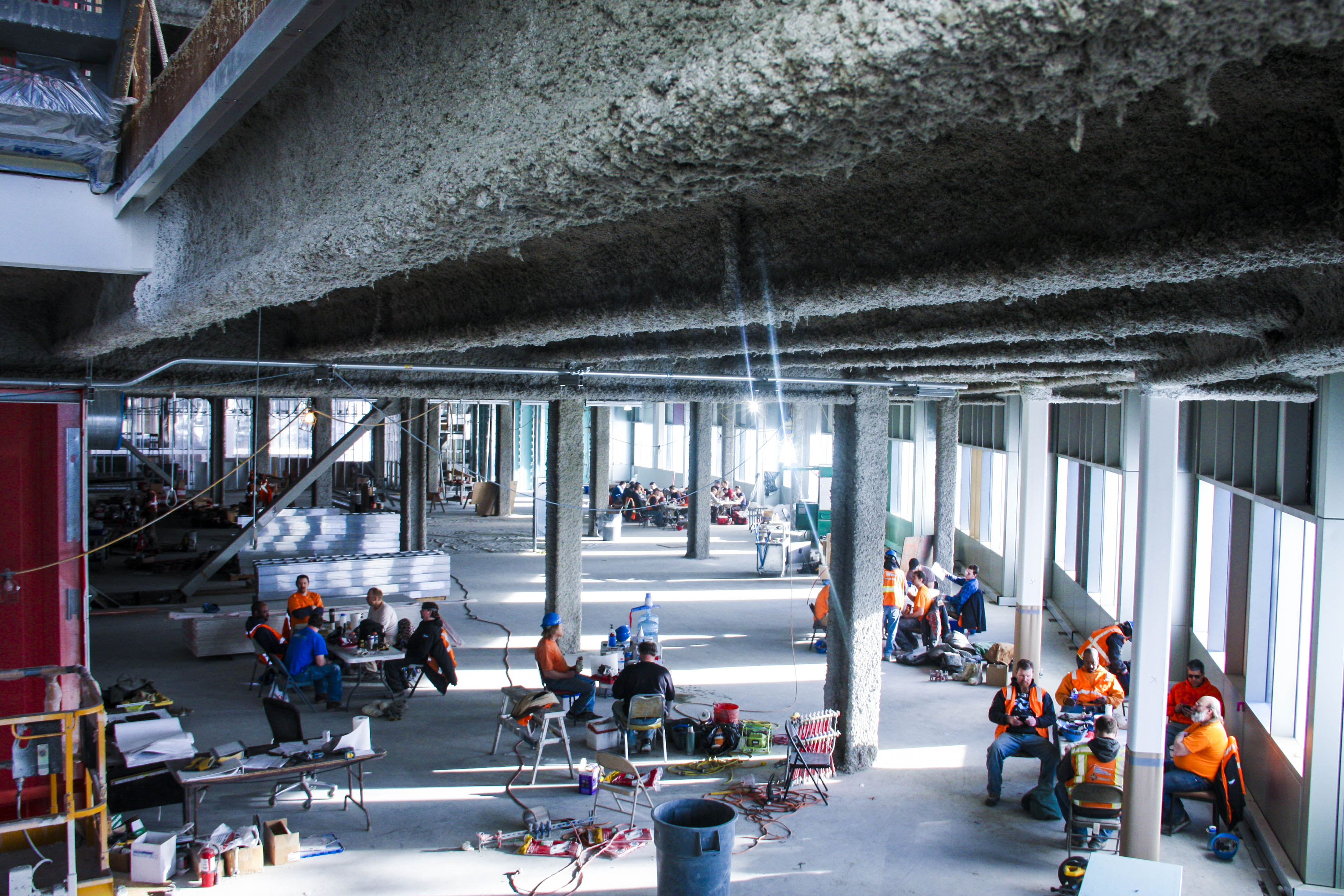 Workers in the engineering building stop for a lunch break during the workday on Friday. - Chris Hoch / Sun Star